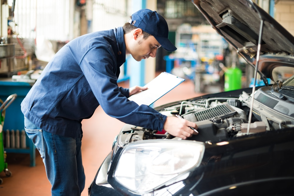 repairman do the car inspection