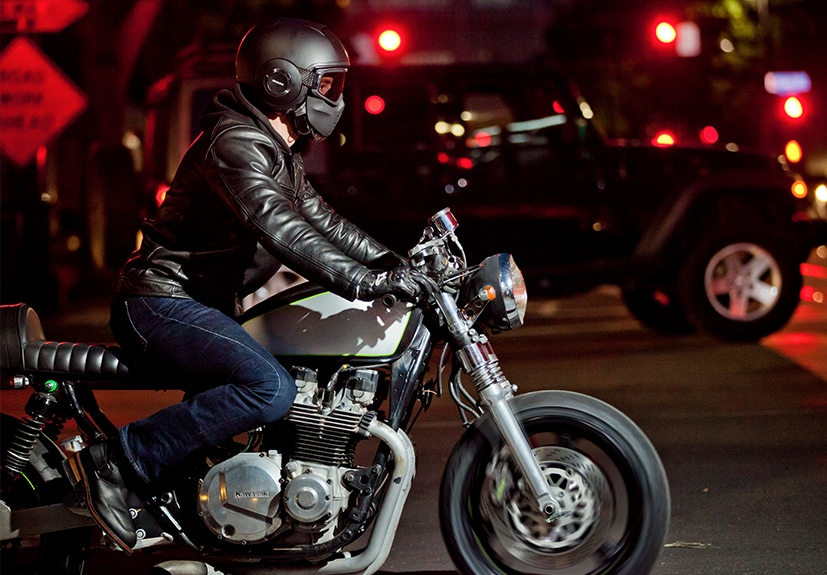 Man riding a motorcycle at night